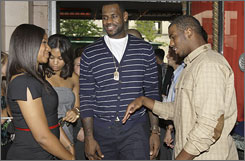 LeBron James, center, and longtime girlfriend Savannah Brinson talk with Hornets star Chris Paul at his documentary premiere.