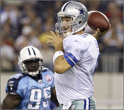 Cowboys quarterback Tony Romo throws a pass during the first half. Romo completed 18 of his 24 passes for 192 yards as Dallas cruised by the Tennessee Titans 30-10.