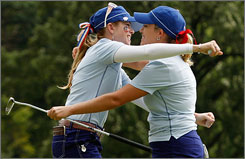 Americans Paula Creamer, left, and Cristie Kerr celebrate after their first-day triumph over Suzann Pettersen and Sophie Gustafson.