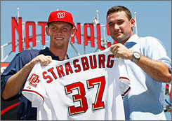Nationals third baseman Ryan Zimmerman, right, welcomes No. 1 overall draft pick Stephen Strasburg to the Nationals.