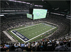 The video board at the Cowboys new stadium runs about 60 yards long and is 25 yards high.