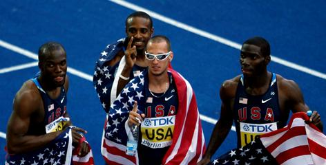 LaShawn Merritt, Angelo Taylor, Jeremy Wariner and Kerron Clement celebrate winning the gold medal in the men's 4x400-meter relay Sunday in Berlin.
