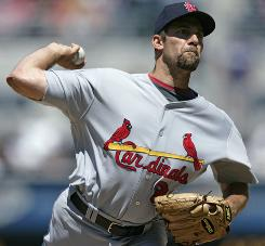 Pitcher John Smoltz struck out nine Padres in five innings Sunday in his Cardinals' debut.
