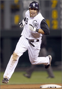 Ryan Spilborghs looks like he's walking on air as he heads home after his grand slam in the last of the 14th inning pushed the red-hot Rockies past the Giants 6-4.