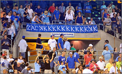 Royals fans show their support for starting pitcher Zack Greinke, who struck out a team-record 15 batters, during Kansas City's 6-2 win over the Cleveland Indians.