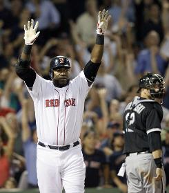 Red Sox' DH David Ortiz celebrates after hitting a solo home run in the bottom of the ninth inning to beat the White Sox.