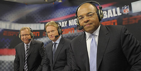 Jon Gruden, center, is joining Ron Jaworski, left, and Mike Tirico for Monday Night Football.