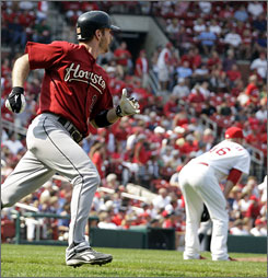 Astros' Jeff Keppinger, left, and Cardinals relief pitcher Kyle McClellan, right, watch Keppinger's home run leave the park in the ninth inning.