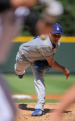 Pitcher Vicente Padilla allowed two runs and six hits in five innings in his Dodgers debut.