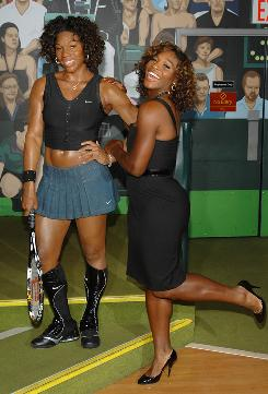 Serena Williams poses at Madame Tussauds next to her wax figure likeness at an unveiling Thursday at Times Square. Williams will defend her U.S. Open title beginning Monday in New York.