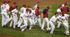 The Cardinals' Albert Pujols, far right, is congratulated by teammates after hitting a walk-off home run to defeat the Nationals.