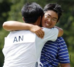Byeong-Hun An hugs his caddie and father, Jae An, after defeating Bhavik Patel in a U.S. Amateur semifinal.