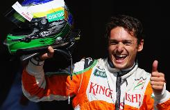 Giancarlo Fisichella of Italy and Force India celebrates after taking pole position.