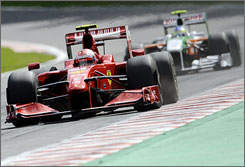 Ferrari's Kimi Raikkonen leads Force India's Giancarlo Fisichella in the late stages at Spa.