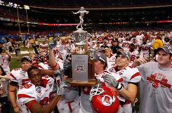 The Utah Utes, shown celebrating their victory over Alabama in the Sugar Bowl, will play No. 14 Oregon late in September in one of many games pitting Mountain West Conference teams against teams from BCS conferences.