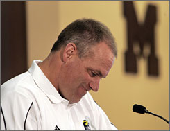 Michigan football coach Rich Rodriguez addresses the news media in Ann Arbor, Mich.
