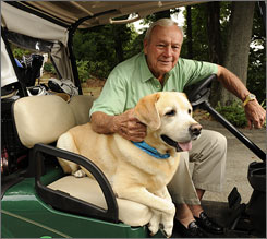 Arnold Palmer is shown at his Pennsylvania home with his dog, Mulligan. Palmer still plays golf on a daily basis.