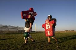 At Dixon High School near Sacramento, junior varsity football players Nick LeBleu, left, and Ryan Gaudy are playing again after a public outcry helped restore sports programs.