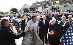 Muhammad Ali, center, unveils a monument Tuesday in Ennis, Ireland, where his great-grandfather used to live.
