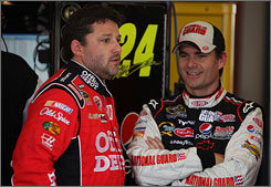 Jeff Gordon, right, chats with Tony Stewart. They've combined to win six titles in NASCAR's top series.