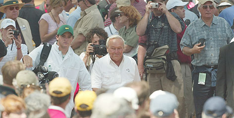 Fans at the 2004 Masters surround Arnold Palmer, who has always drawn a crowd during his nearly 60-year career as a golfer.