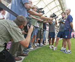 U.S. coach Bob Bradley, right, talks to the media after practice Friday in Sandy, Utah.