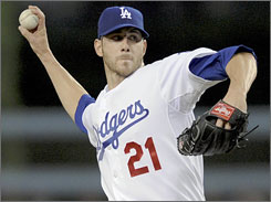 Jon Garland wears a Dodgers uniform while pitching to his old team, the Arizona Diamondbacks, on Thursday.
