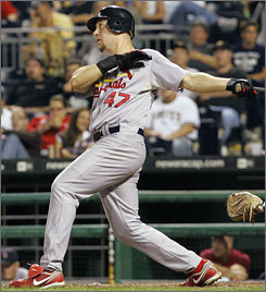 The Cardinals' Ryan Ludwick follows through on a three-run home run off Pirates pitcher Phil Dumatrait in the eighth inning. It was Ludwick's second home run of the game.