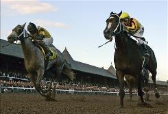 Rachel Alexandra, right, and jockey Calvin Borel held off Macho Again with jockey Robby Albarado Saturday to win the Woodward Stakes at Saratoga Race Course in Saratoga Springs, N.Y.