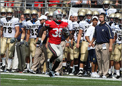 Brian Rolle's interception on a two-point conversion stopped Navy's bid to tie the game and gave Ohio State a four-point lead.