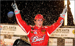 Kasey Kahne enjoys the spoils of victory lane at Atlanta Motor Speedway for the second time in his career after winning Sunday's 500-miler.