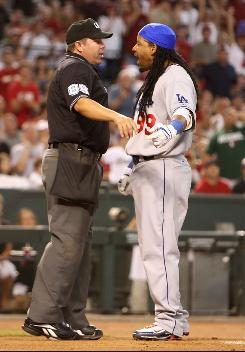 Manny Ramirez homered to help the Dodgers to an early lead but was ejected by umpire Doug Eddings after flinging his bat and helmet after striking out to end the third inning. The Dodgers beat the Diamondbacks 7-2 and remain 3 1/2 games ahead of the Rockies in the National League West.