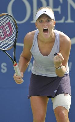 Melanie Oudin of the USA celebrates a service break during the third set of her victory Monday against Nadia Petrova at the U.S. Open.