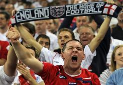 English fans cheer at Wembley Stadium as their team takes on Croatia on Wednesday.