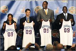 Rutgers women's coach C. Vivian Stringer, and former NBA basketball players John Stockton, David Robinson and Michael Jordan display jerseys during the April 6, 2009 Hall of Fame announcement in Detroit.