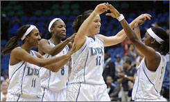 The Lynx's Candice Wiggins (11), Rashanda McCants (8), Anna Montanana (12) and Roneeka Hodges (5) celebrate after Montanana scored on a putback with 28.6 seconds left in Minnesota's 75-72 win over Detroit.