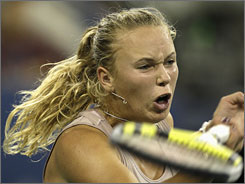 Caroline Wozniacki grimaces as she returns a shot to Melanie Oudin during their U.S. Open match.