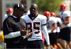 Marvin Lewis, left, Chad Ochocinco and the Bengals are looking to rebound from a 4-11-1 season.