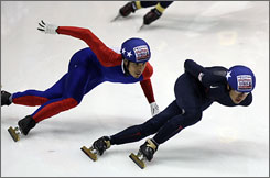 J.R. Celski, right, leads Apolo Anton Ohno on Wednesday in the first turn of a 500-meter semifinal event in the U.S. short-track speedskating championships in Marquette, Mich.
