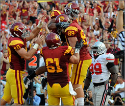 Southern California celebrates a touchdown against Ohio State during their victory in Los Angeles last year.
