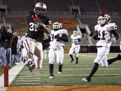 Union running back Jeremy Smith high steps into the end zone against Jenks High School during the Class 6A state championship football game in December of last year. The two teams meet again on Friday.