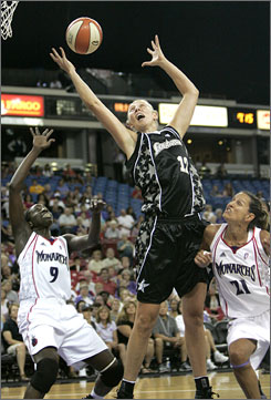 San Antonio Silver Stars center Ann Wauters goes up for a rebound against Sacramento's Hamchetou Maiga-Ba.