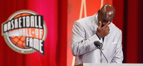 Michael Jordan pauses during his induction speech at the Naismith Memorial Basketball Hall of Fame.