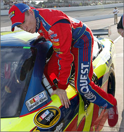 Mark Martin exits his car after recording the pole-winning lap Friday at Richmond International Raceway.