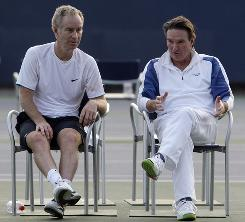 Former tennis greats John McEnroe, left, and Jimmy Connors, taking a break after a hitting session this year at the U.S. Open, were part of the inaugural Super Saturday 25 years ago at the Open that has been called the greatest day in tennis. McEnroe won their match on that day and then went on to win the title.