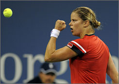 Kim Clijsters pumps her first after winning a game in the first set. Clijsters, the 2005 champion, defeated defending champ Serena Williams 6-4, 7-5.
