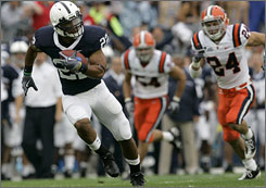 Penn State running back Evan Royster breaks through the Syracuse on his way to a first-quarter touchdown.