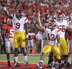 Southern California's Stafon Johnson celebrates after scoring the game's first touchdown.
