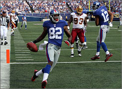 Mario Manningham scored a touchdown after a toss from Eli Manning against Washington on Sunday.