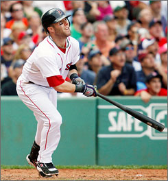 The Red Sox's Dustin Pedroia watches his two-run home run in the eighth inning of the first game of a doubleheader.